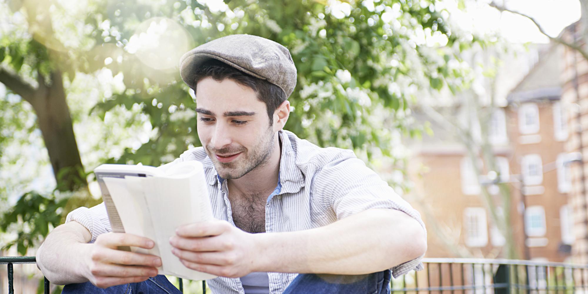 man writing a book