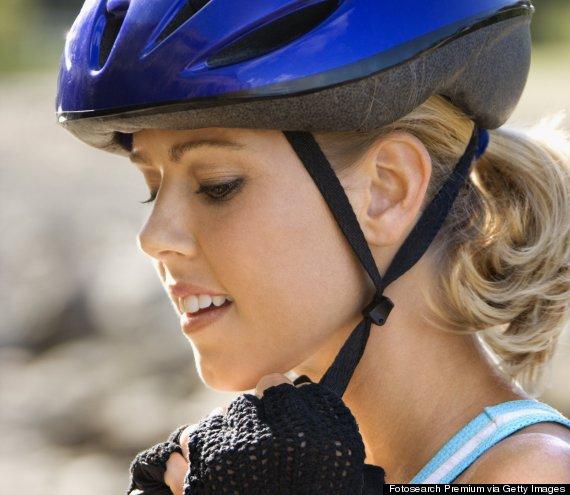 putting on helmet
