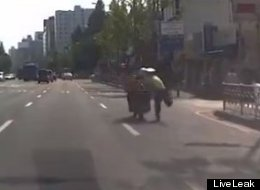 WATCH: Korean Cop Is Dragged 200m By Motorcyclist