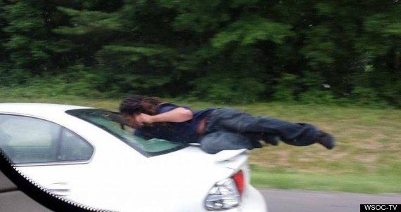 man on car