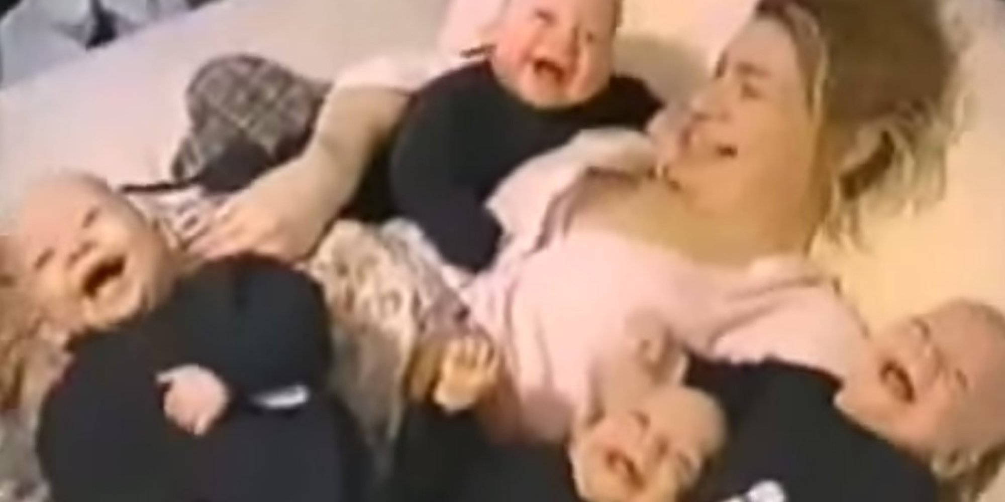 dad makes quadruplets laugh