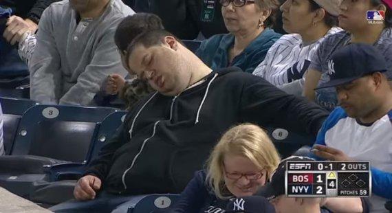 sleeping baseball fan