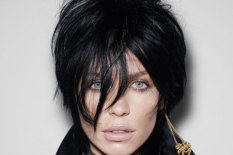 Model wearing black spiky wig | Pic: Macmillan/Rankin