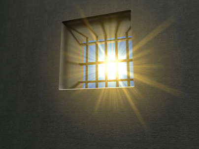 Prison cell with sunlight coming through window
