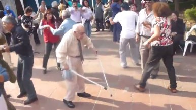 elderly man ditches canes to dance