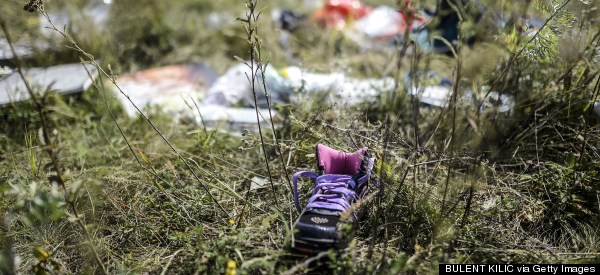 'Death Hunters' Cause More Grief For Families Of MH17 Victims