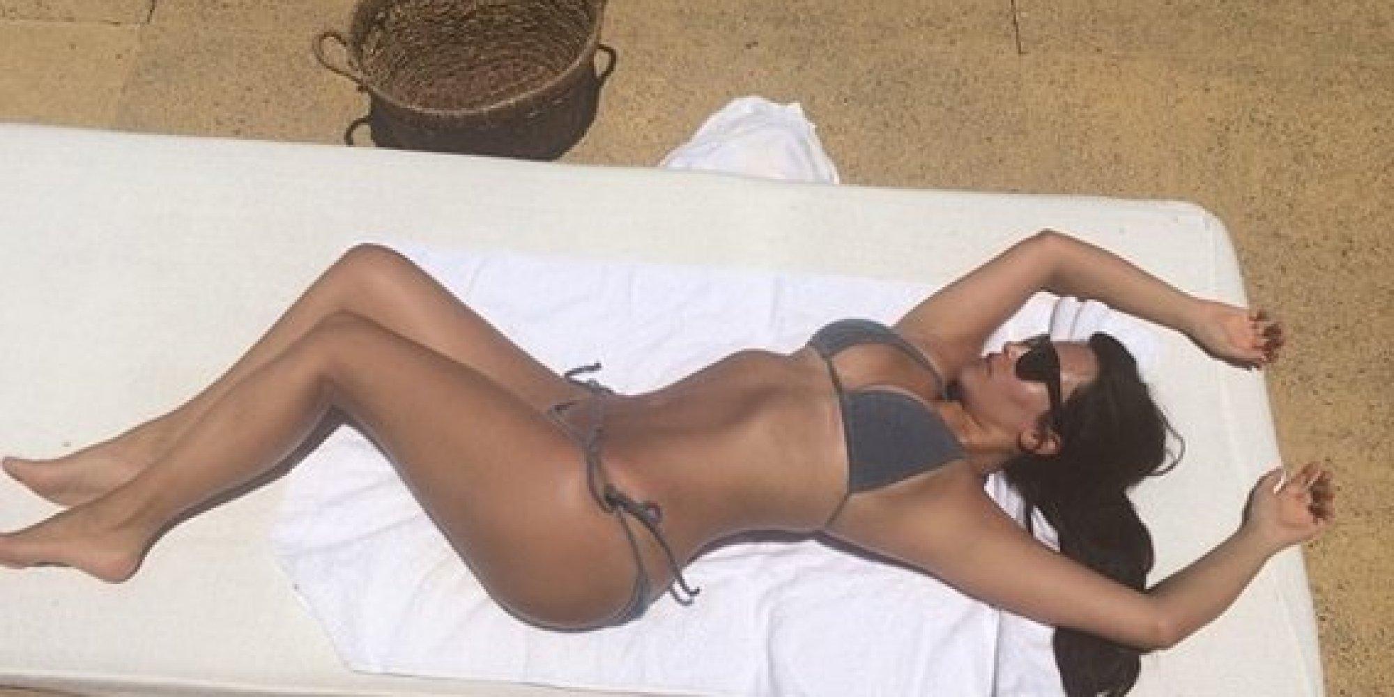 Kim Kardashian Tans In A Bikini Because She S Always On