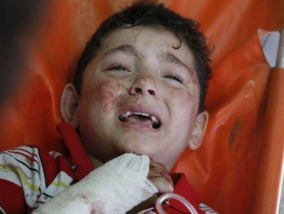 A Palestinian child wounded in an Israeli strike on a UN shelter