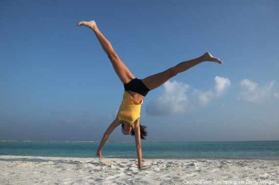 woman cartwheel beach