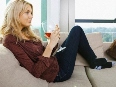 Stock image of a woman with a glass of wine