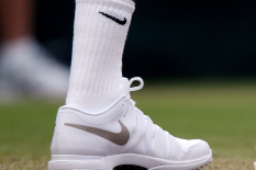 Tennis player wearing Nike shoes and socks