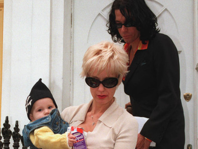 Tiger Lily with mother, Paula Yates, and father, Michael Hutchence, in the mid 1990s