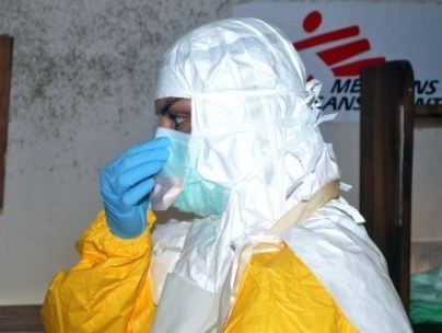 A member of Doctors Without Borders (MSF) puts on protective gear