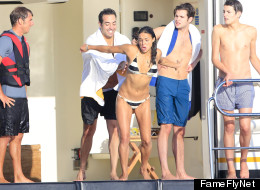 Here Are Pics Of An Unsuspecting Michelle Rodriguez Getting Pushed In The Water