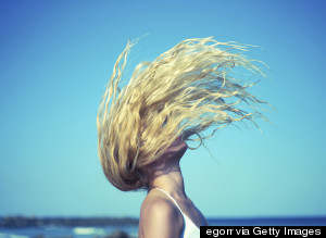WOMAN HAIR BEACH