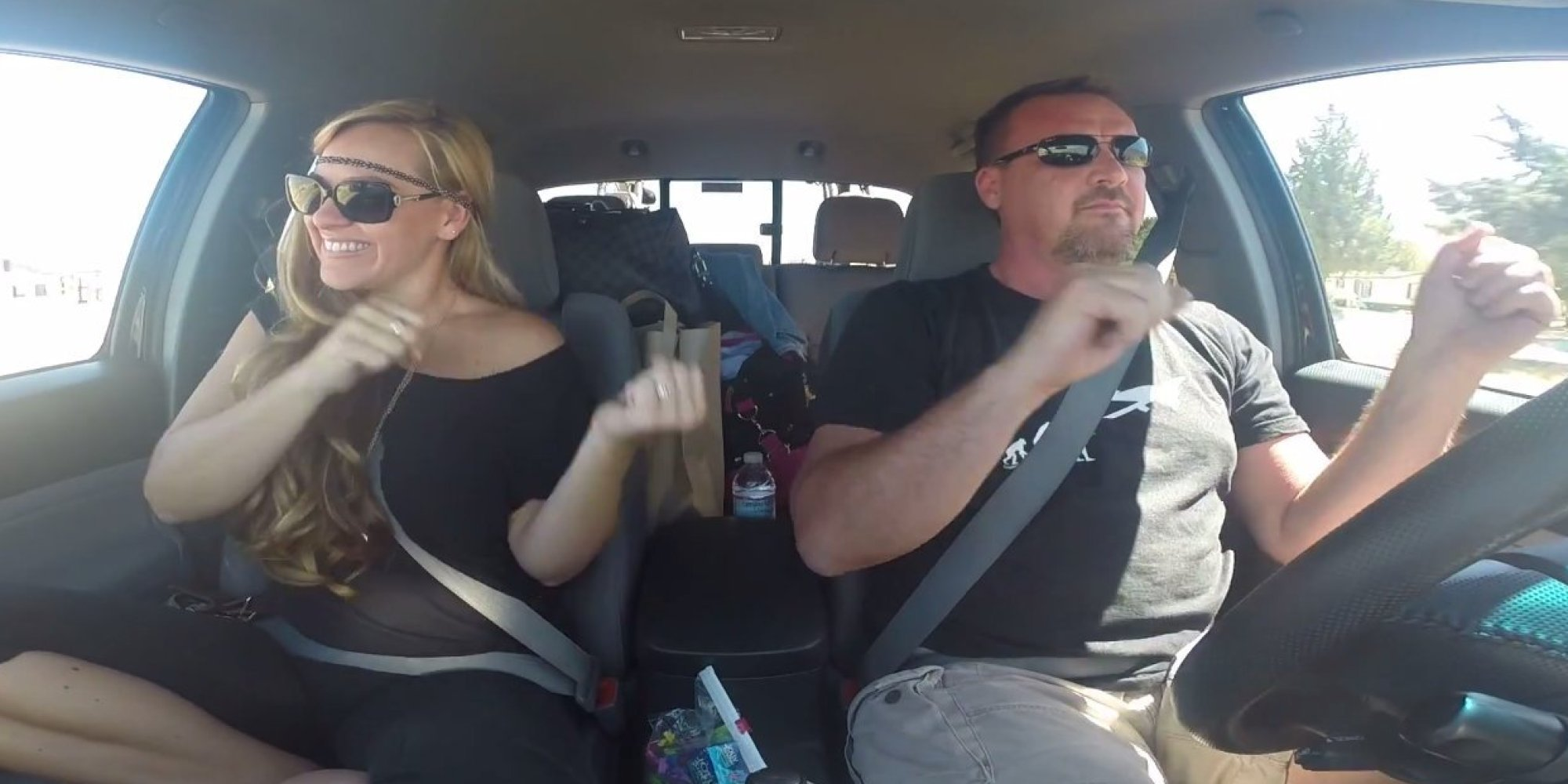 Couples Sign Language Singalong Will Put A Smile On Your Face - Car sign language