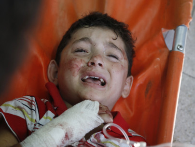 A Palestinian child wounded in an Israeli strike on a compound housing a UN school