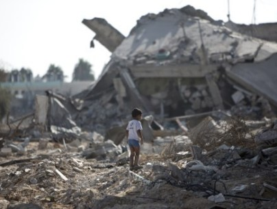 A boy in Gaza amongst rubble