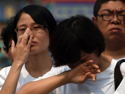 People mourning the victims of flight MH370