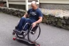 Man in wheelchair on skateboard | Pic: YouTube