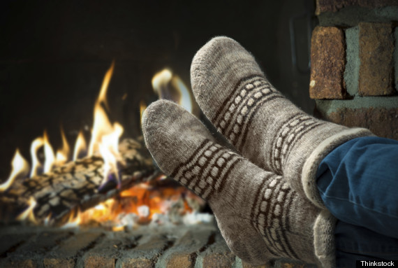 feet by a fireplace