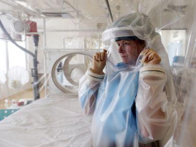 Woman demonstrates isolation apparatus