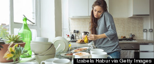WOMAN IN MESSY KITCHEN