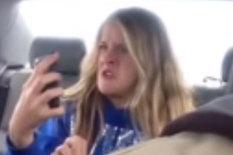 Girl taking a selfie in car | Pic: YouTube/Rumble Viral