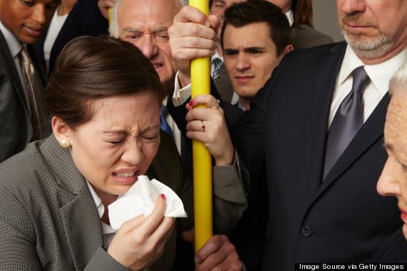 man sneezing train