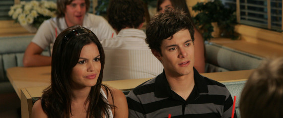 Rachel Bilson as Summer sitting at restaurant table with Adam Brody as ...