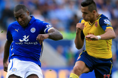 Arsenal's Alexis Sanchez (right) and Leicester's Wes Morgan | Pic: PA
