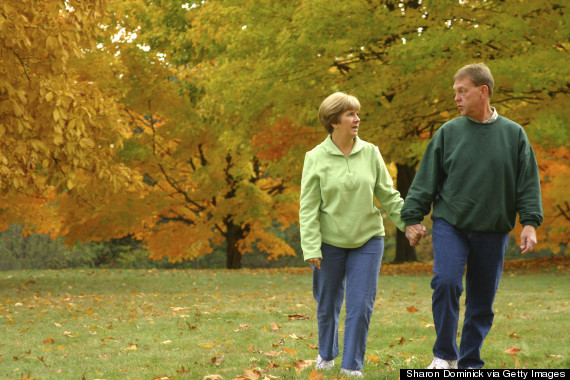 older couple exercising in fall