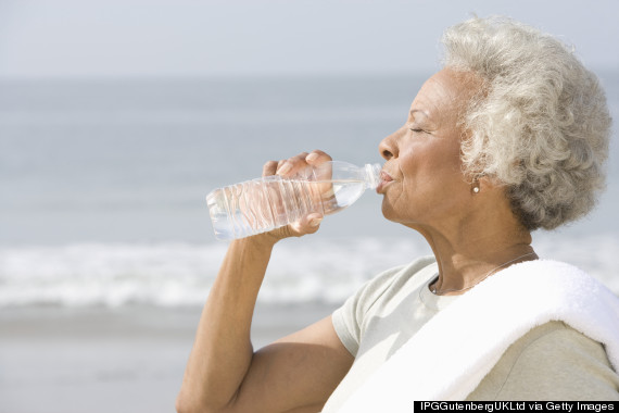 older person drinking water