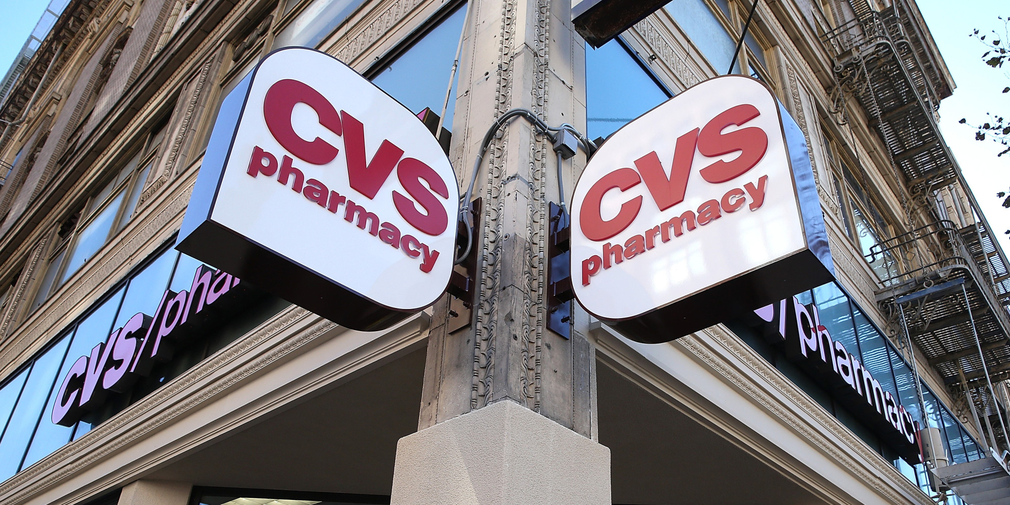 cvs to charge some customers more for using pharmacies that sell cigarettes