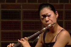 Butterfly on flautist's face | Pic: Youtube
