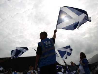 Yes supporters wave the Saltire