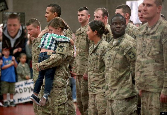 toddler greets soldier mother