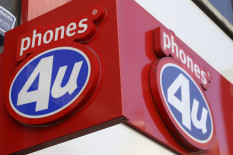 Phones4u sign | Pic: PA