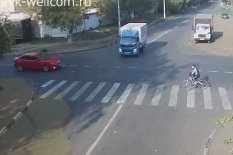 Man on a bike at crossing | Pic: YouTube