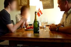 Dad taking to sons across a table | Pic: YouTube