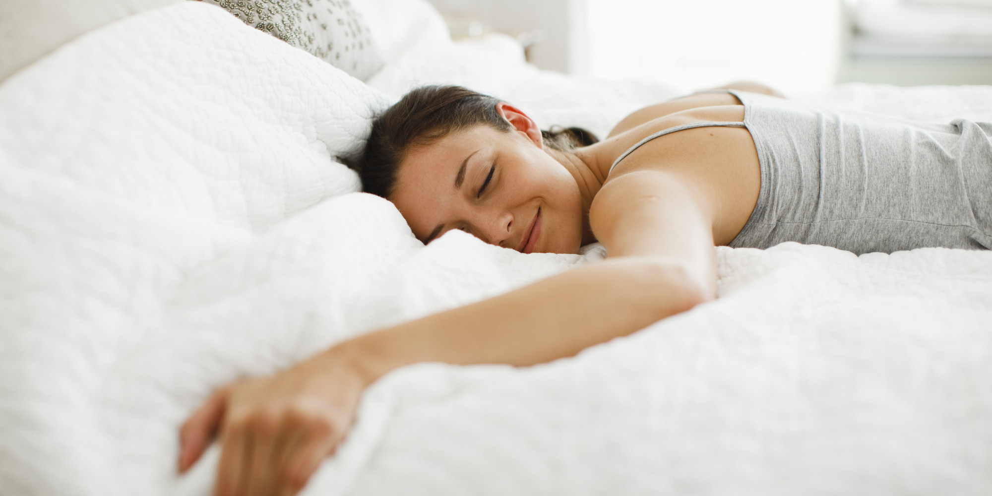 Woman lying on the bed about to go to sleep