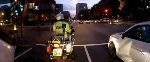 DRIVER JUMPS RED LIGHT POLICE MOTORBIKE