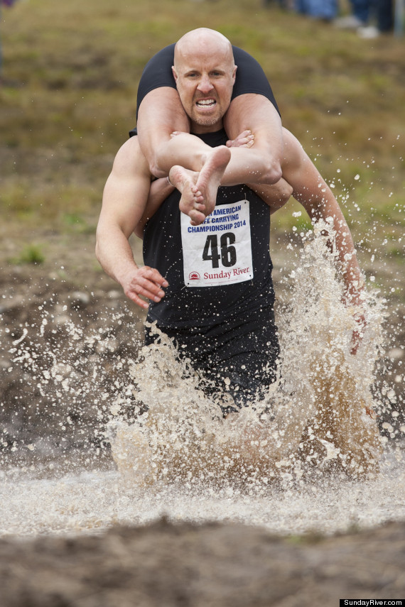 Wife carrying competition has couples compete to win woman s weight in
