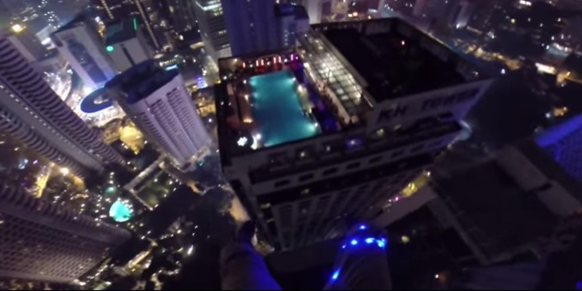 Base jumpers leap from kuala lumpur tower in malaysia - Rooftop swimming pool kuala lumpur ...