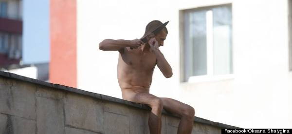 Naked Russian Activist Cuts Off His Earlobe In Act Of Protest