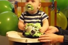 Baby covered in cake | Pic: YouTube