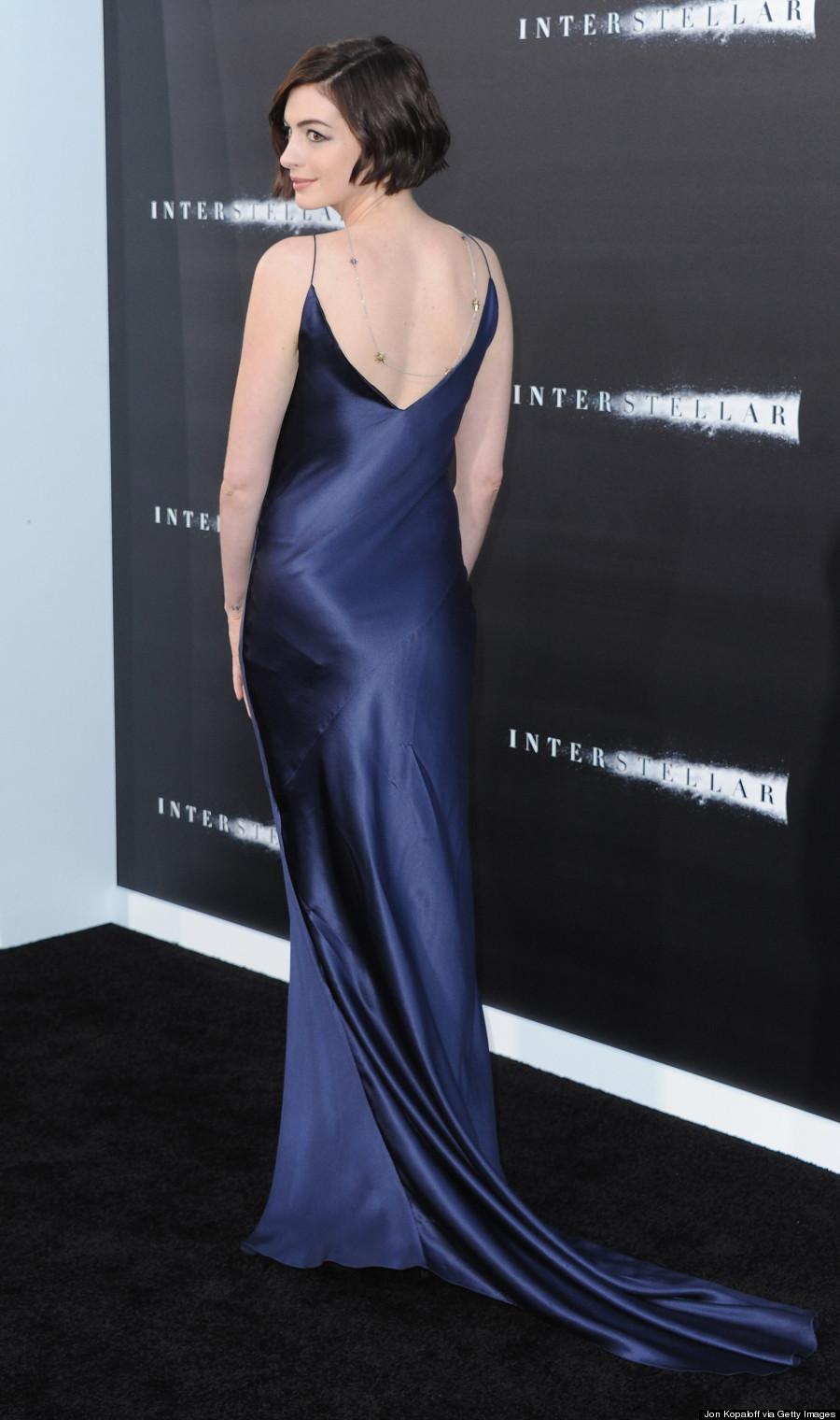 Anne Hathaway Rocks A Boudoir Look In Slinky Satin Dress