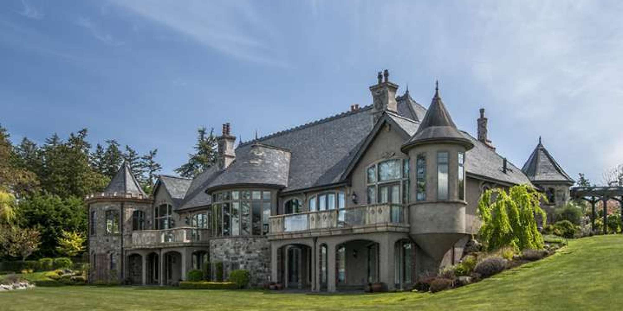 Castle for sale in saanich has hand carved doors elevator for Castle mansions for sale