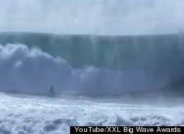 Teen Surfer Escapes Monster Wave, Proves She's A Total Badass