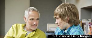 MAN TALKING TO TEENAGER